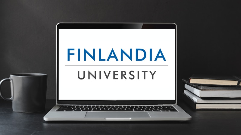 Finlandia University logo on a laptop.