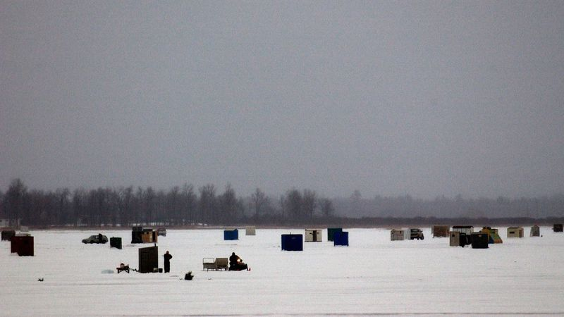 Ice shanties/shacks are seen on an ice covered lake. (Michigan DNR Photo)