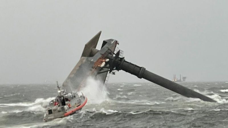 A boat is seen capsized in the waters of the Gulf of Mexico. The U.S. Coast Guard is responding.
