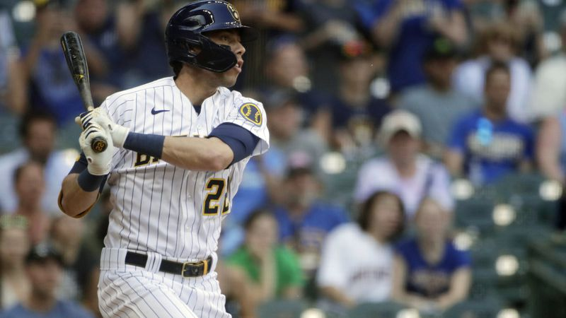 Milwaukee Brewers' Christian Yelich hits an RBI sacrifice fly during the seventh inning of a...
