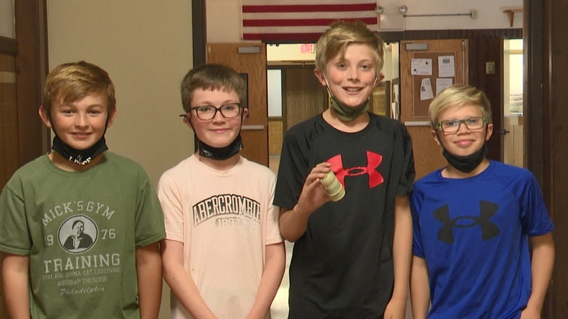 The four boys raised over $300 for the food programs at the Salvation Army of Marquette County