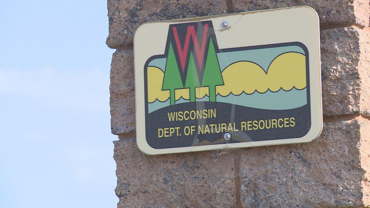 Wisconsin DNR logo on building.