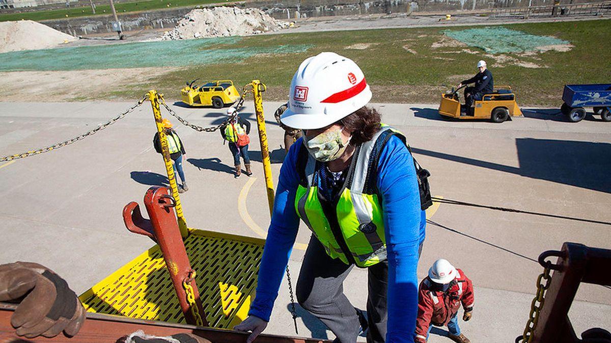 "A CCHD employee named Jill climbs aboard a vessel for the ""Shots on Ships"" program."