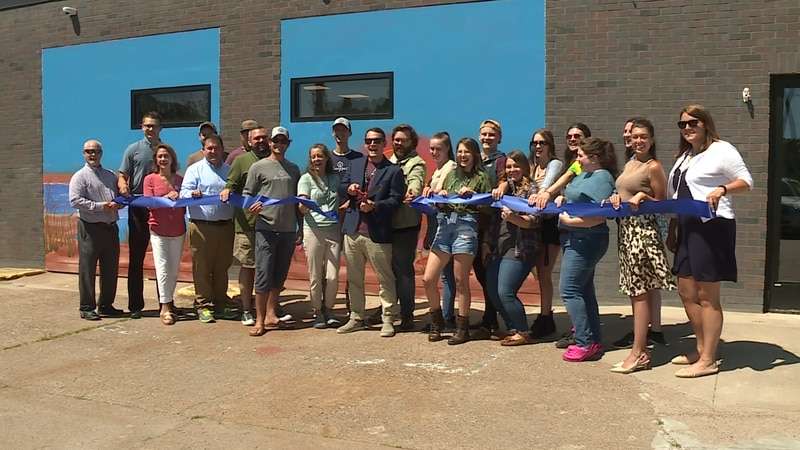 Store staff and LSCP members at ribbon cutting for Dunegrass