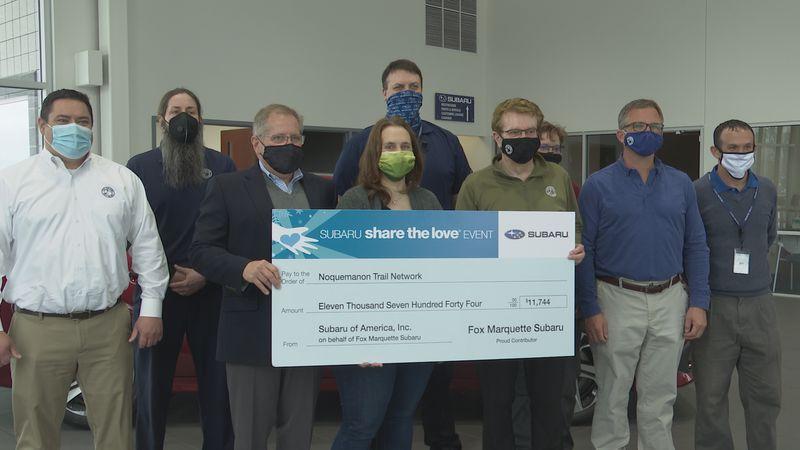 Lori Hauswirth, NTN Executive Director, was at the Subaru dealership to receive the check.