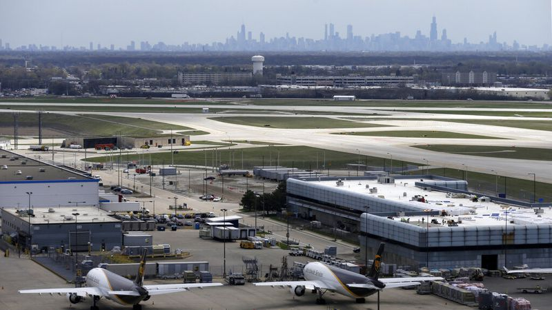 A view of downtown Chicago skyline is seen from the south air traffic control tower at O'Hare...