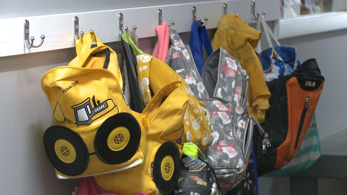 FILE. Backpacks hang in the hallway at a child care center.