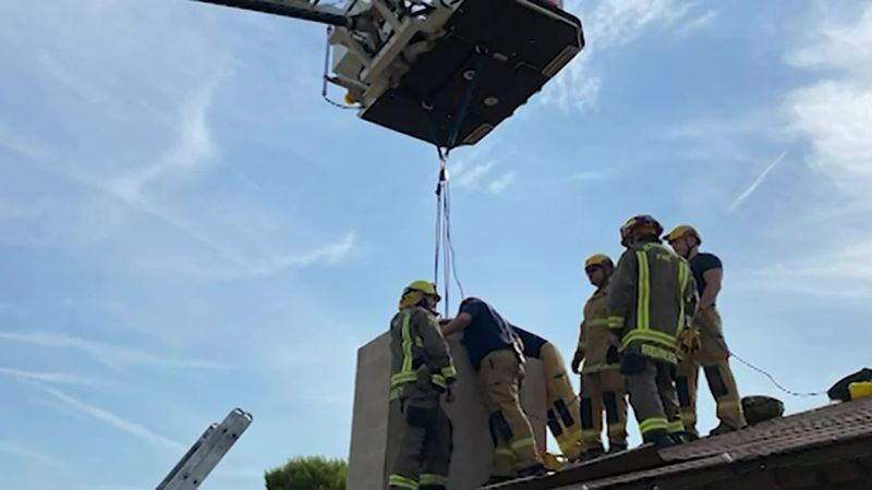 A woman was freed by first responders after climbing into a chimney.