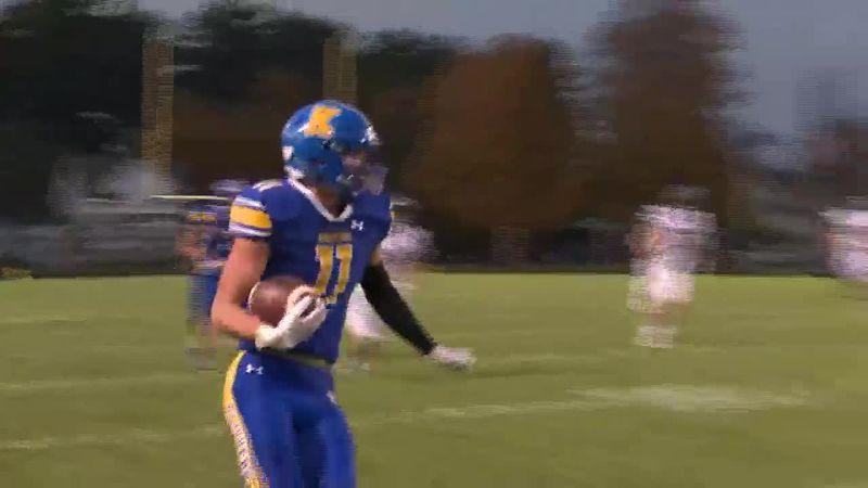 Kingsford's Zach Person catches pass from quarterback Mike Meneguzzo.