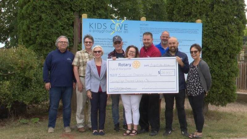 Marquette West Rotary Club donates $28,000 check for new playground