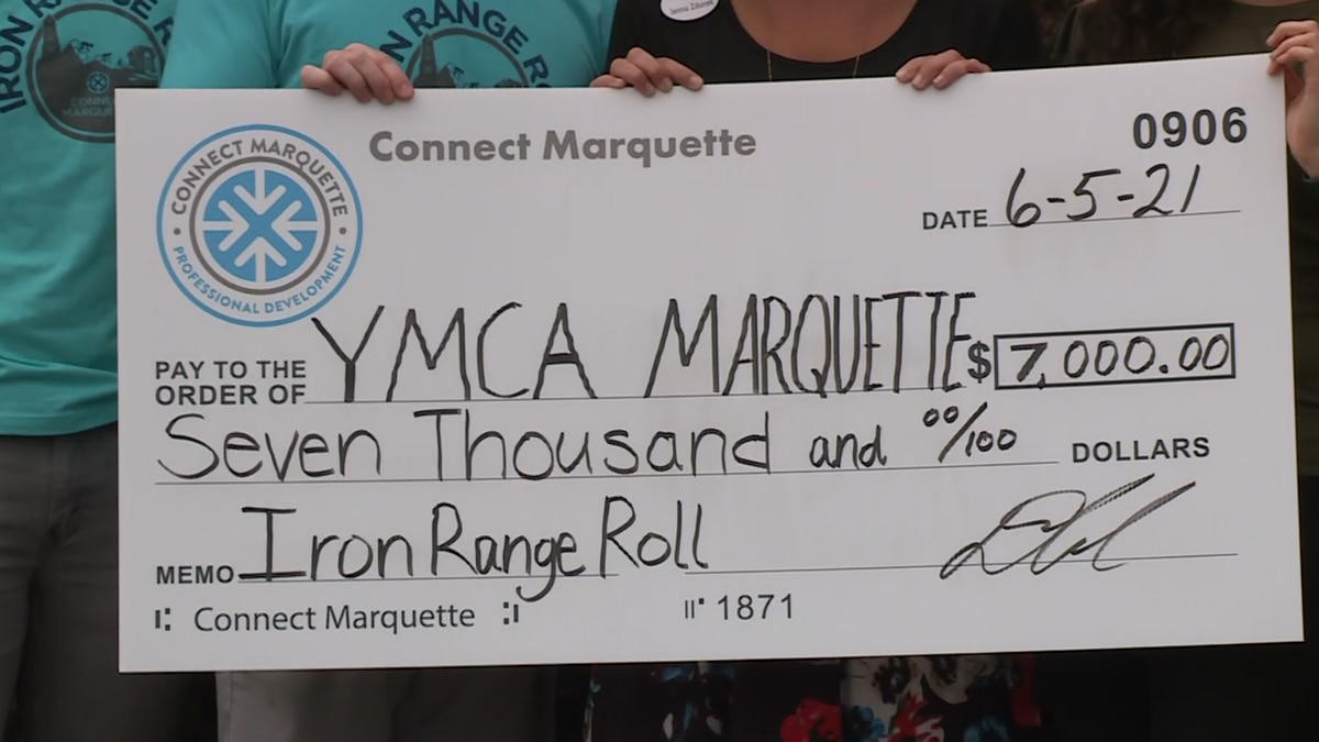 The check for $7,000 to the YMCA of Marquette County