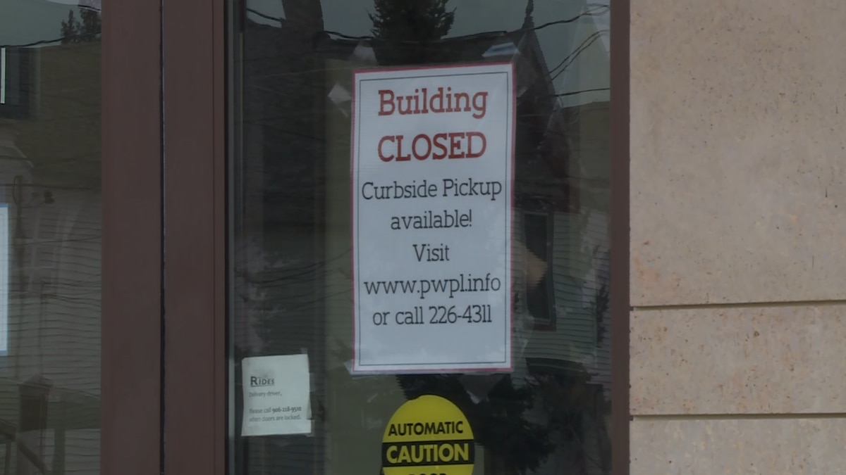 A sign on the front door of the PWPL announcing its closure