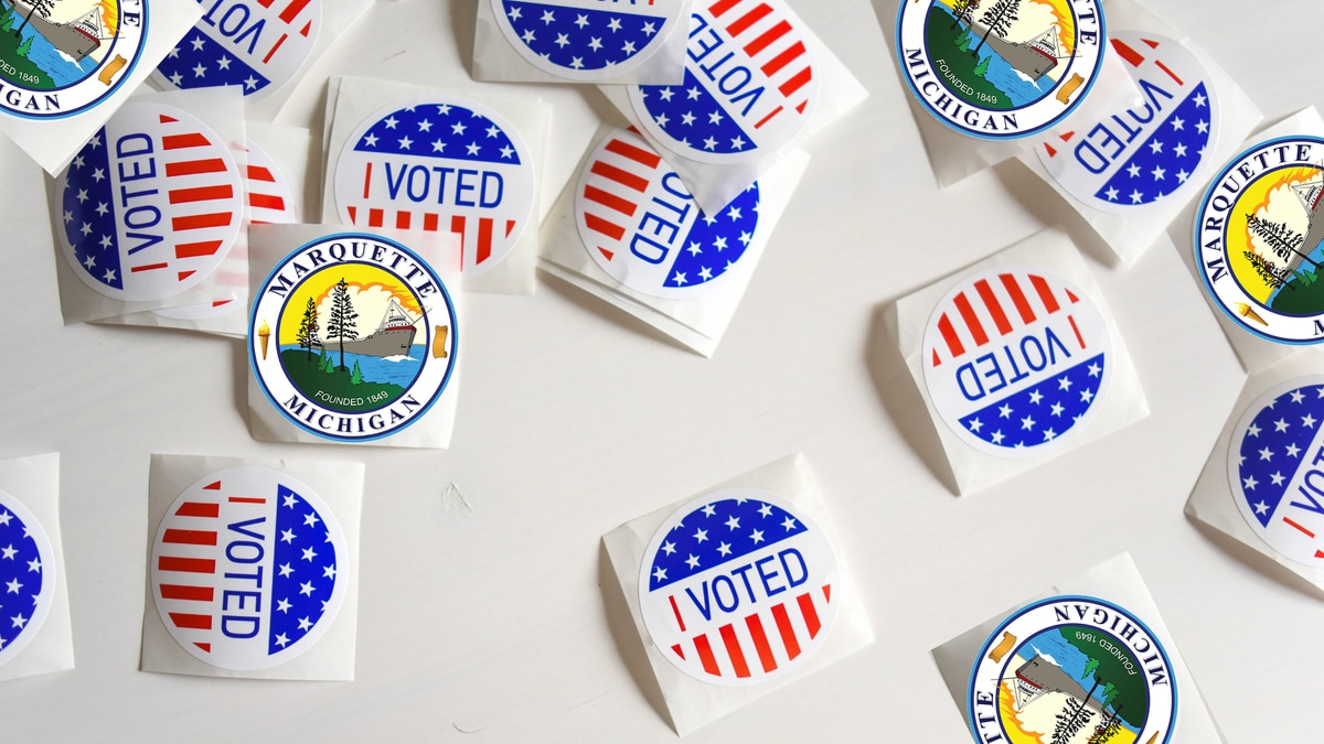 Marquette City Seal and 'I voted' stickers.