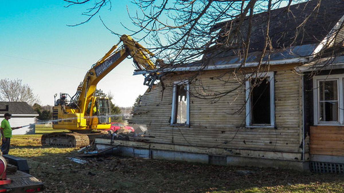 A home being demolished in Iron County.
