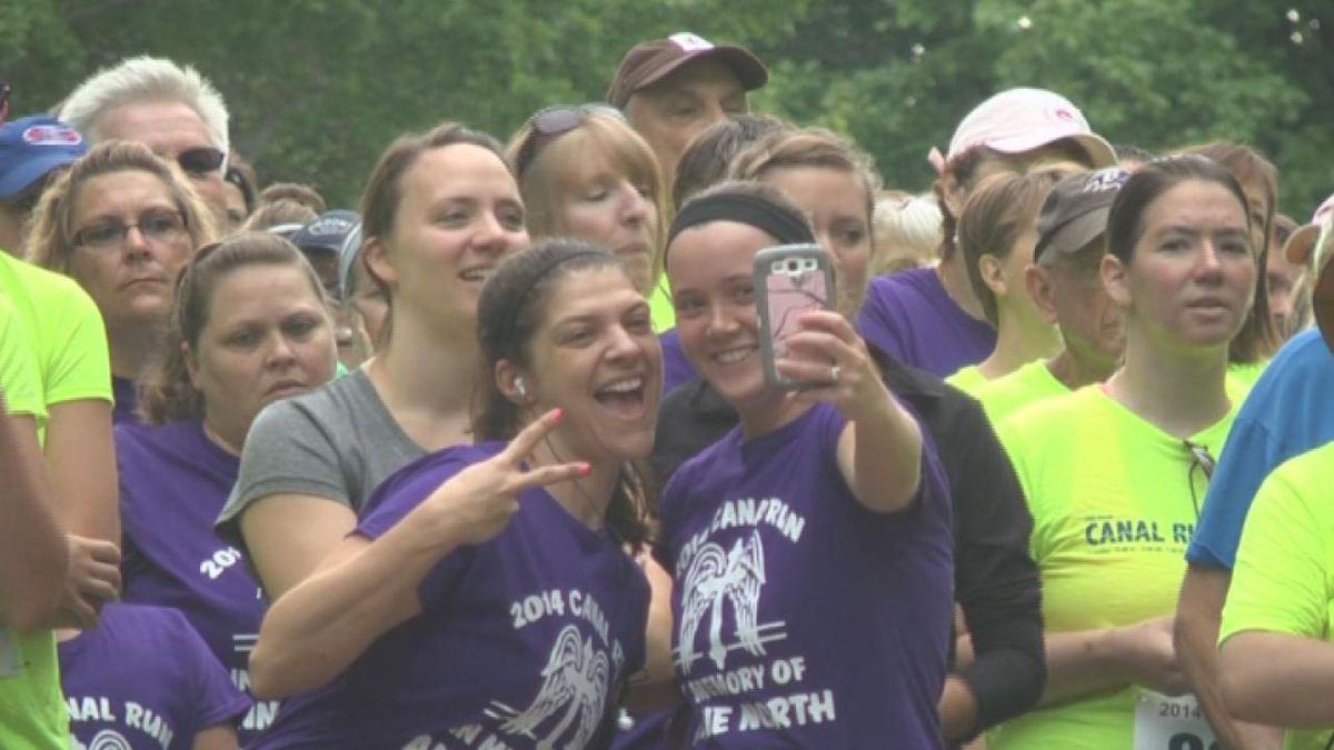 Two girls take a selfie during the 2018 Canal Run.