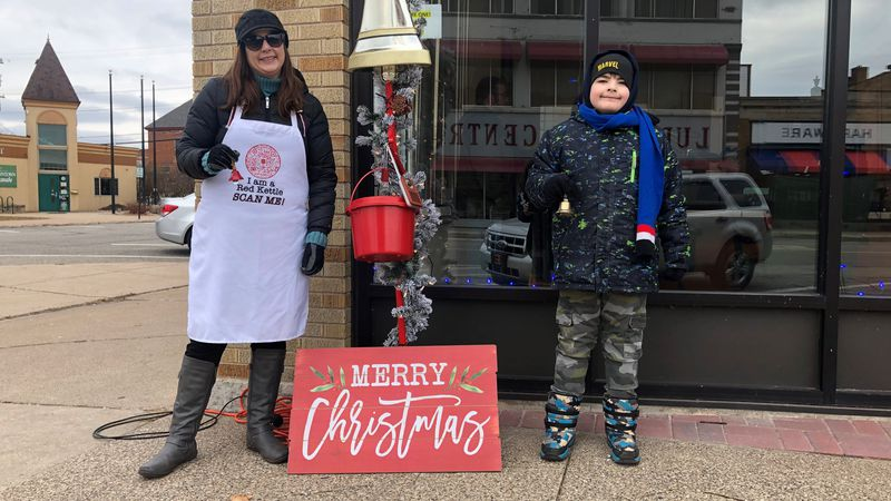 Jessica (left) and her son, RJ (right), ringing the bell outside RRN Media Plaza.