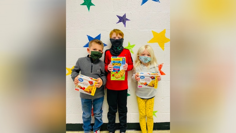 Menominee's Central Elementary students (Dennan Ahrndt, Chase Buelteman, and Mara Spies) with...