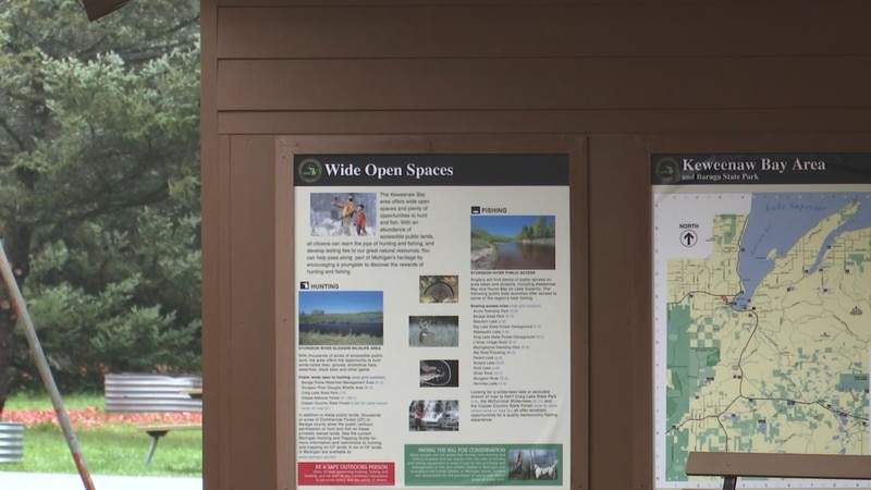 This sign shows campers a map of the area.