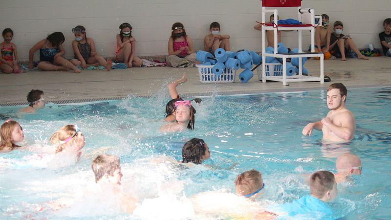 Northern Lights YMCA Dickinson Center aquatic director Tanner Walsh instructs Niagara...