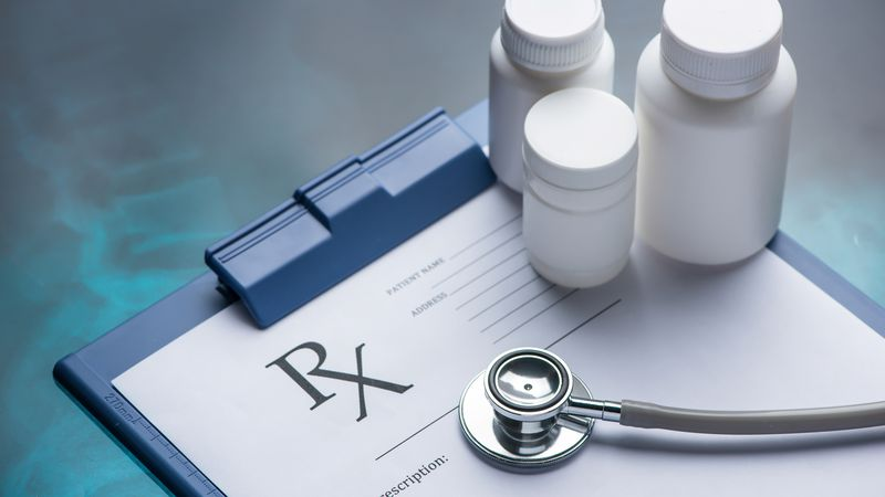 Close-up of RX prescription and stethoscope on x-ray
