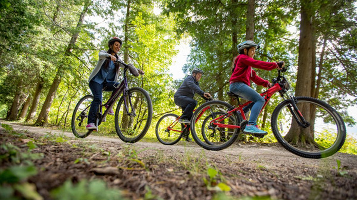 A family biking at Peninsula State Park in Door County where new park upgrades were unveiled in...
