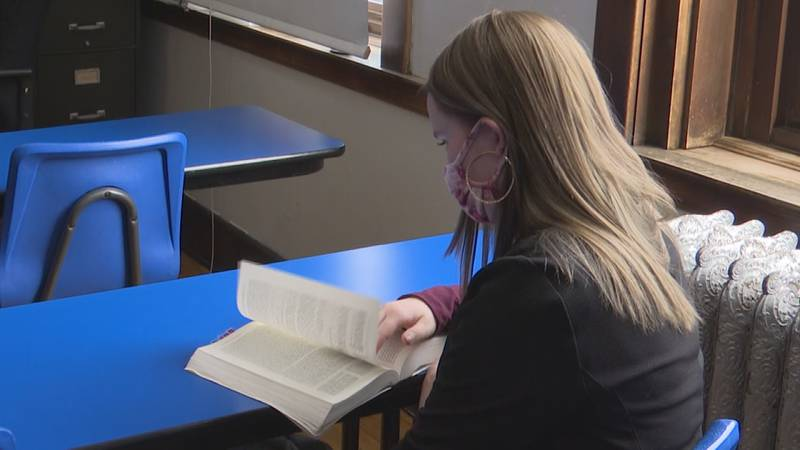 A student wears a mask while studying during the 2020 - 2021 school year.