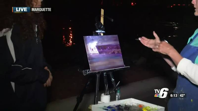 Julie Highlen paints en plein air for the TV6 Morning News.