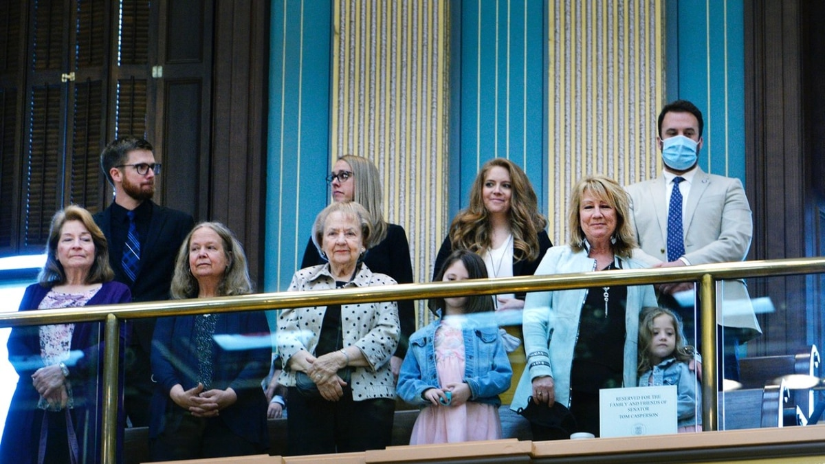 Members of former Sen. Tom Casperson's family stand as they are recognized by the state Senate...