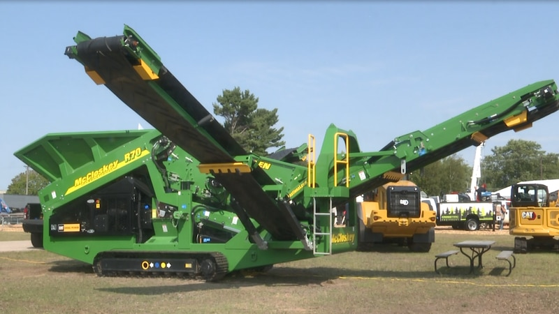 Multiple logging companies showcase their equipment and heavy machinery