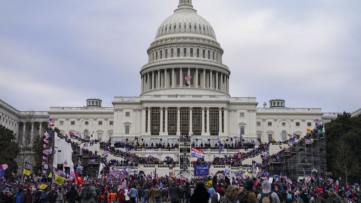 Trump supporters gather outside the Capitol, Wednesday, Jan. 6, 2021, in Washington. As...