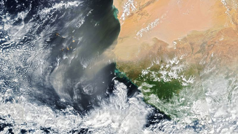 A low-pressure system over North Africa lofted a large plume of dust toward Europe and the...