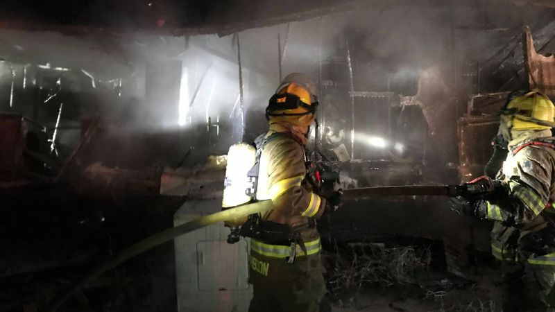 Town of Peshtigo Fire Department crew members fighting a mobile home fire on Hale Road the...