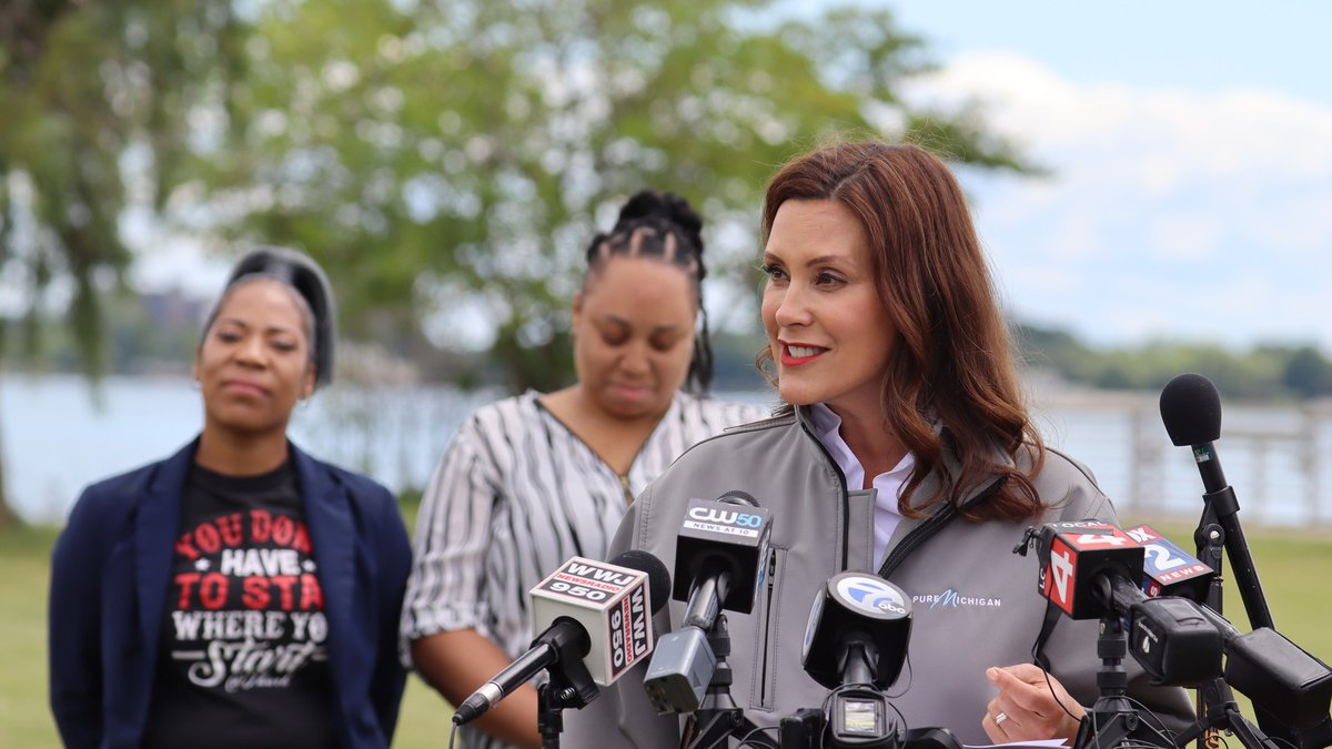 Gov. Gretchen Whitmer celebrates the end of most Michigan COVID-19 restrictions during an event...