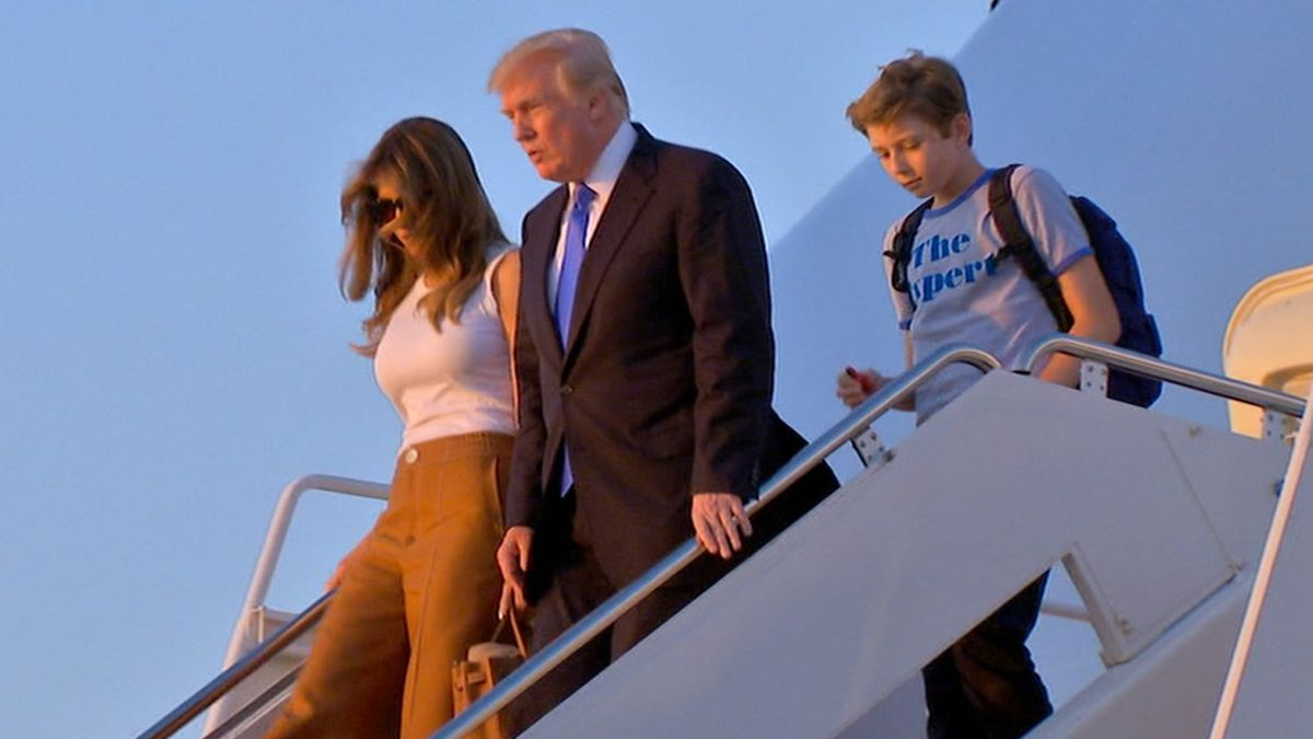 One of the people impersonated online was Barron Trump, right, shown here with former President...