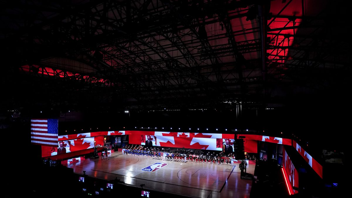 The Canada flag is seen on video boards during the playing of the Canadian national anthem...