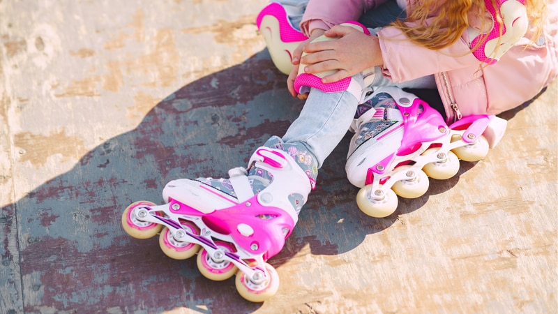 FILE. A girl taking a rest while roller blading.