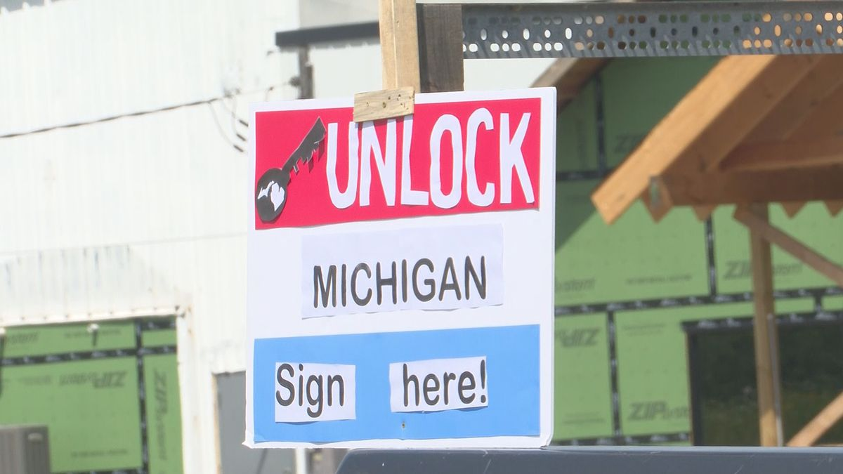 "An ""Unlock Michigan"" sign is seen in Dickinson County, July 2020."