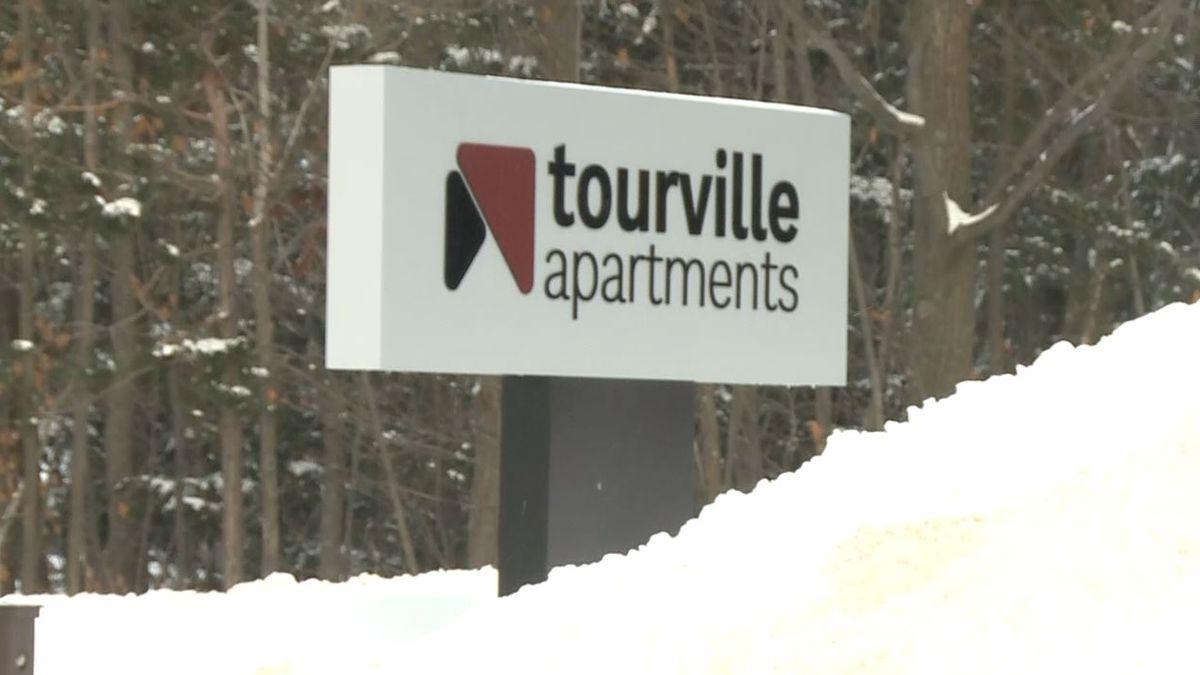 Tourville Apartments sign. (WLUC Photo)