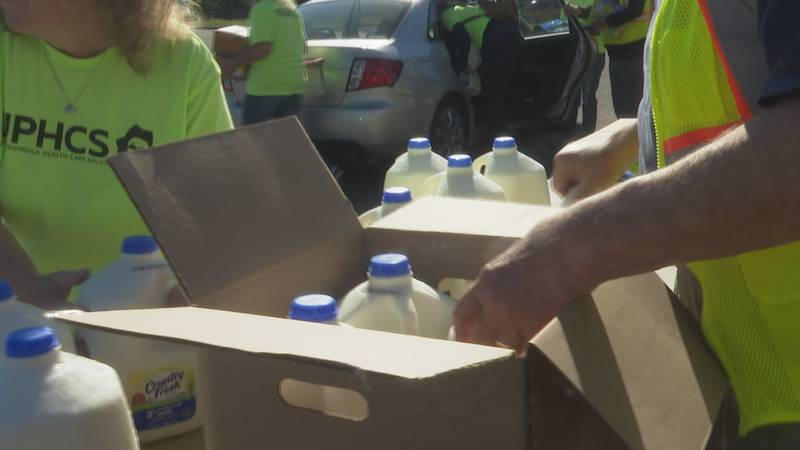 22 volunteers from Marquette organizations gathered to distribute food to families.