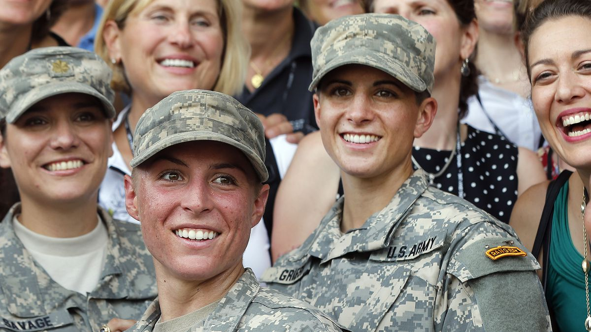 FILE - In this Aug. 21, 2015, file photo, Army 1st Lt. Shaye Haver, center, and Capt. Kristen...