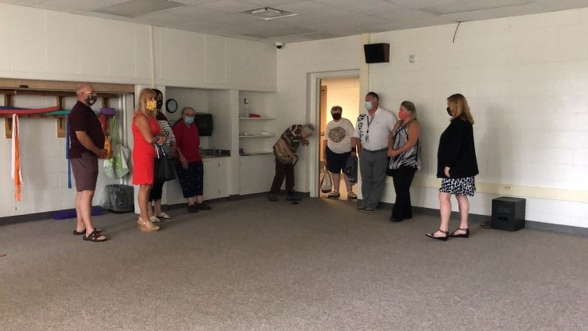Rotary Club touring the Wells Center building.