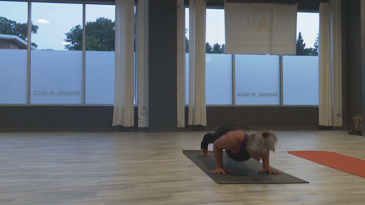 Alluma Yoga's manager practices in the newly opened studio.
