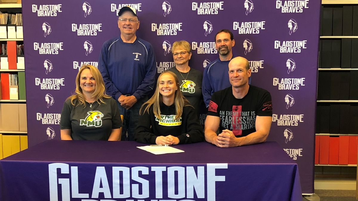 Ahna Larson, her parents and her coaches.
