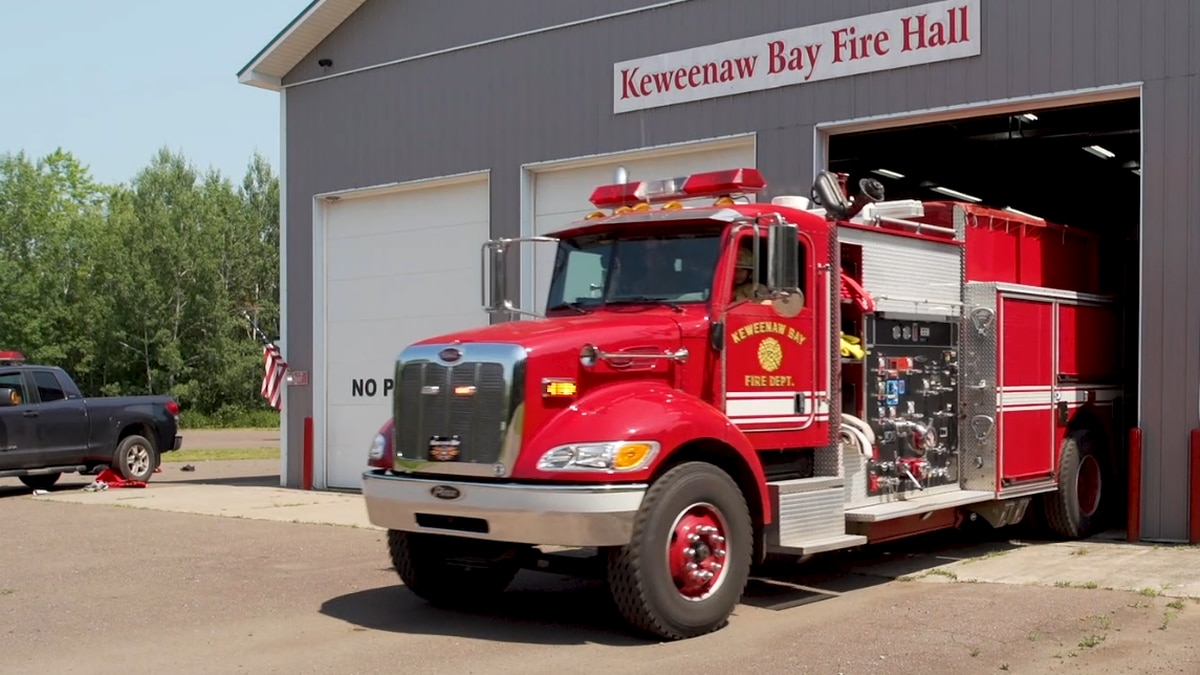 FILE. Keweenaw Bay Fire Department truck driving out of the fire hall.