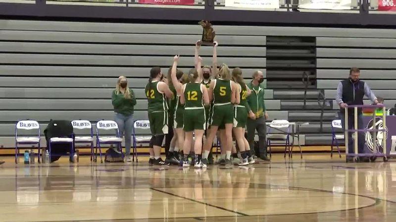 Carney-Nadeau Wolves celebrate with Girls Basketball Regional Trophy.