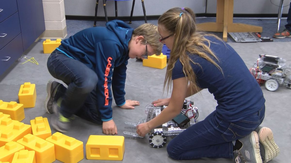 Kingsford Middle School Robotics members work on their project. (WLUC Photo)