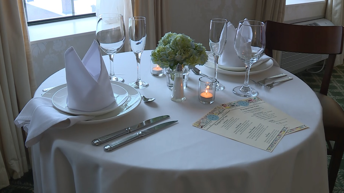 A table set up for the Landmark Inn's passport for two dining