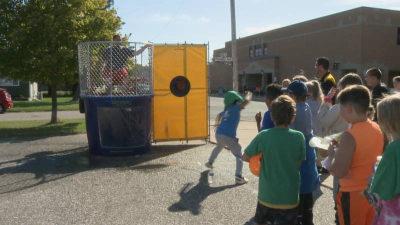 Students try to soak Principal William Traber in the dunk tank.