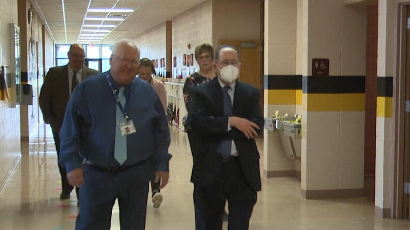 Dr. Rice walks with ETC Superintendent David Radovich and others.