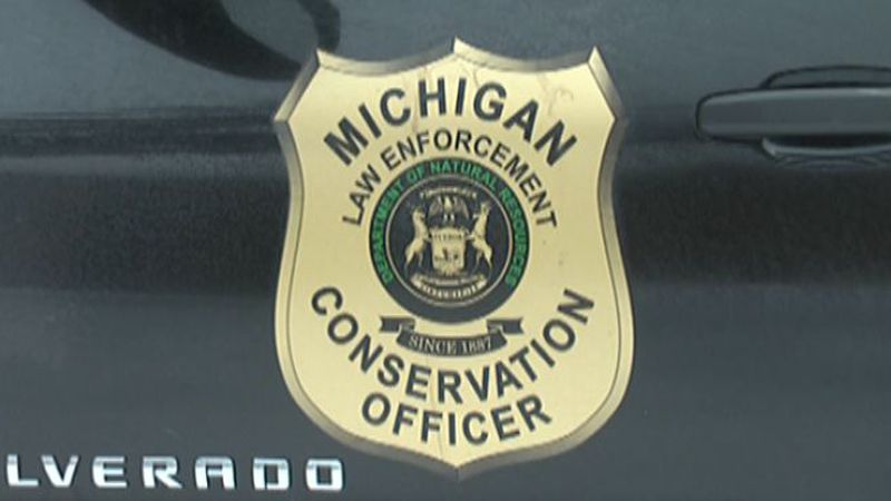 Side of a Michigan Conservation Officer patrol truck.